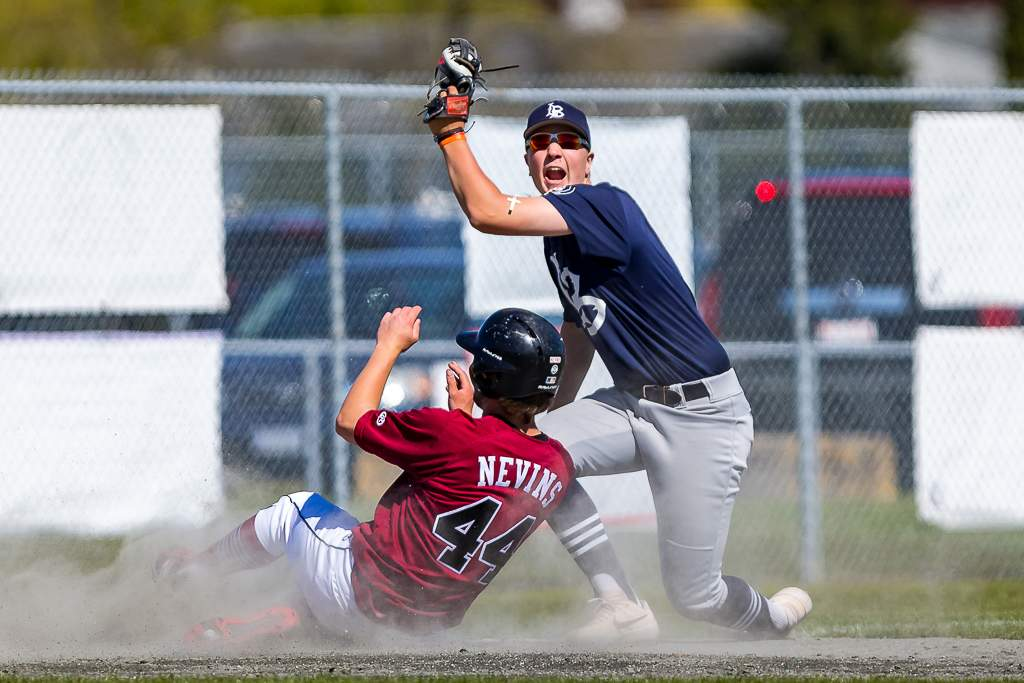 April 28, 2019, Victoria, BC - Langley third baseman Tommy Palazoff comes up with the ball and with a yell after tagging out the Eagles Witt Nevins on this play Sunday (Photo: Christian J. Stewart)
