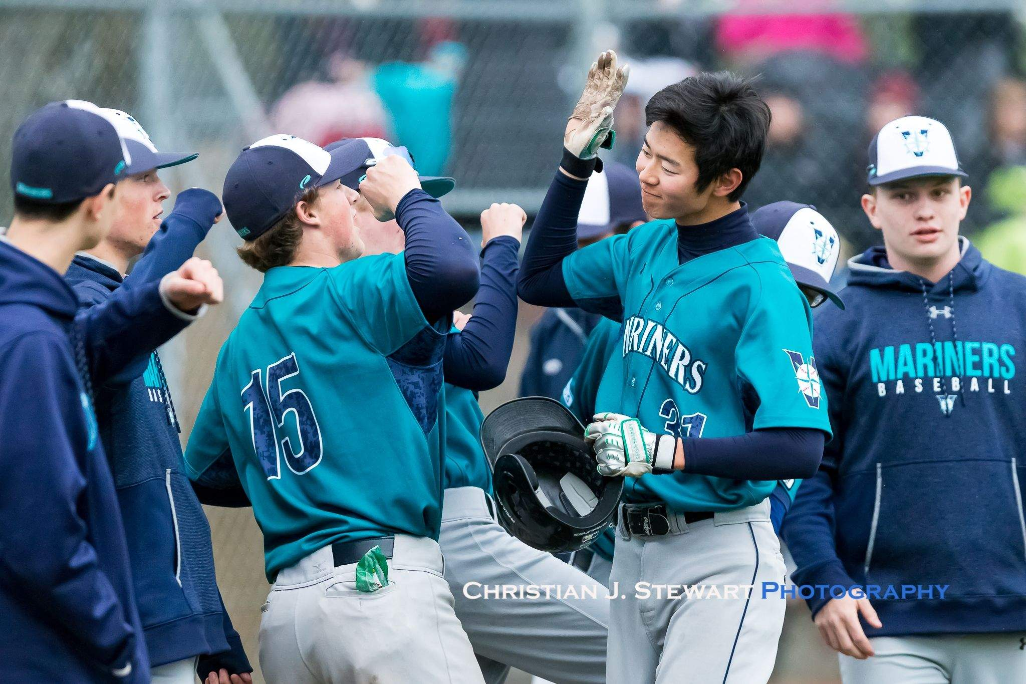 The Mariners Kodai Yaoita (31 right) is congratulated by Rhys Hill (15 left) after scoring in the first inning against the Eagles on Tuesday (Photo: Christian J. Stewart)