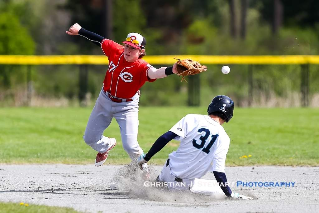 April 21, 2019, Victoria, BC - Mariners baserunner Kodai Yaoita (31) slides safely into second as the throw eludes Reds' second baseman Will Ireland (17) on this play in game one Sunday (Photo Christian J. Stewart)