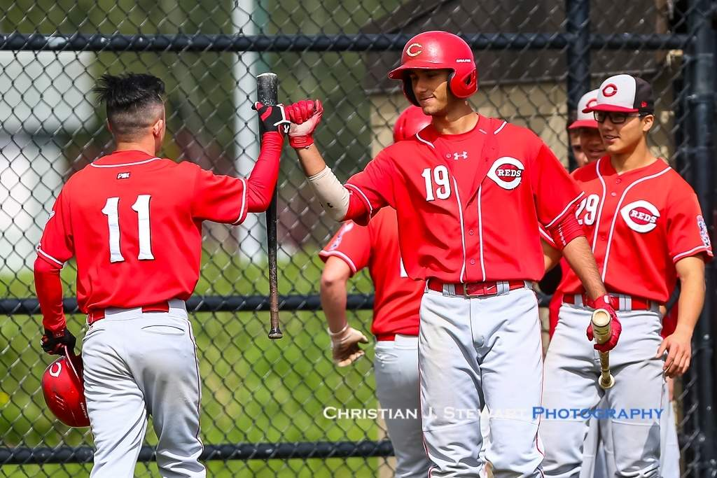 April 21, 2019, Victoria, BC - The Reds Ben Mar (11) and Madjik MacKenzie (19) celebrate early runs against the Mariners in game one Sunday (Photo: Christian J. Stewart)