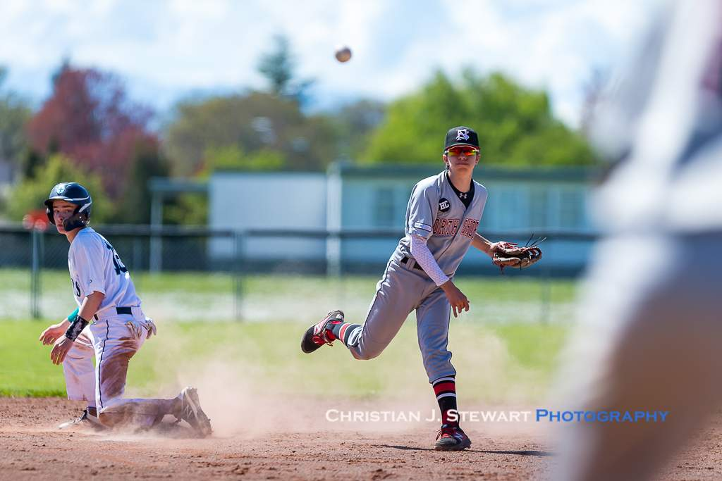 April 28, 2019, Victoria, BC - Twins shortstop Anthony Setticasi watches his throw as he turns a double play against the Mariners Sunday (Photo: Christian J. Stewart)