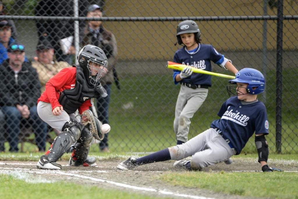Lakehill's 2, Matt Brown safe at home. Photo by Gord Rufh ISN Sports