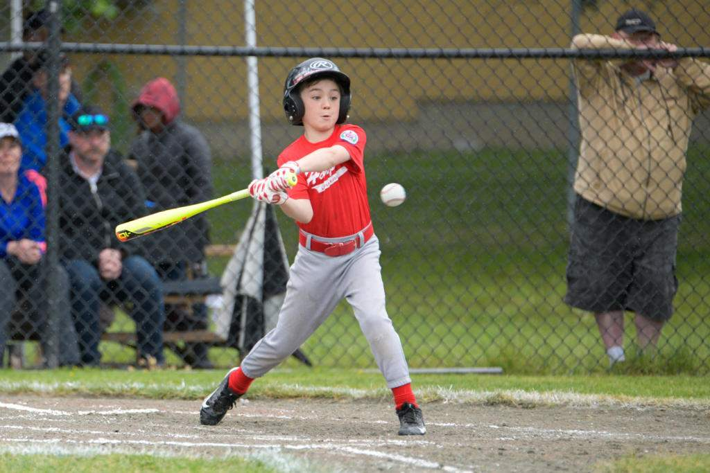 Hampton Park player swings at the ball during the bronze medal match against Lakehill 2. photo by Gord Rufh ISN Sports