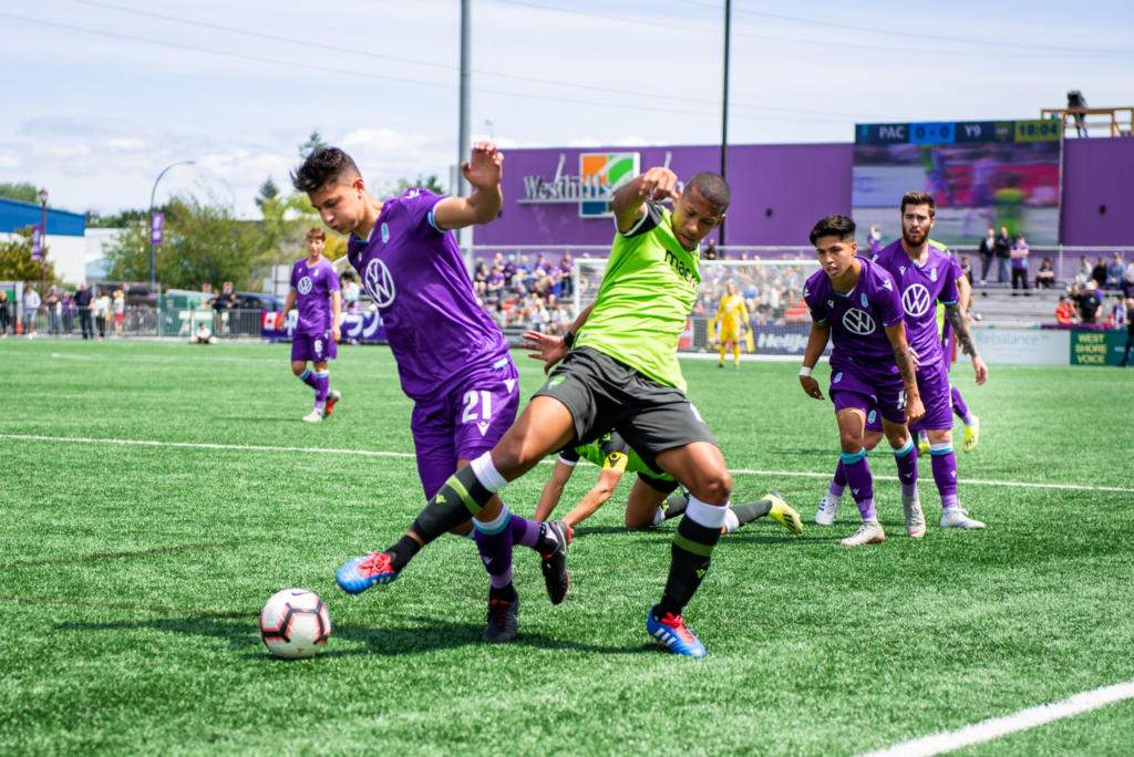 Pacific FC's Alessandro Hojabrpour and York9's Ryan Telfer