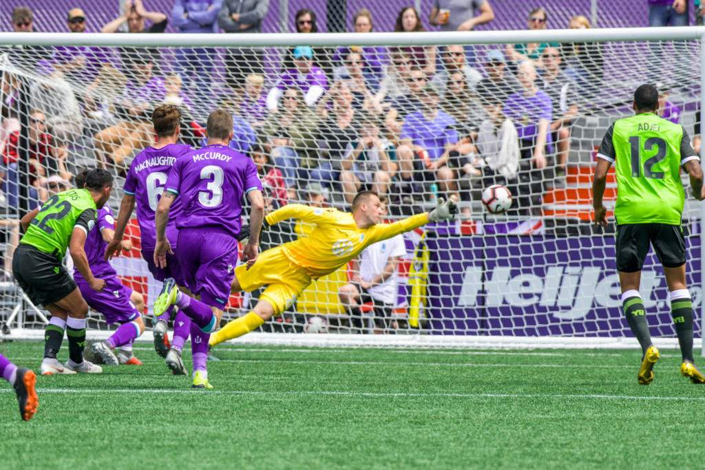 Pacific FC's Mark Village catches a break as the ball hots the post. Photo by Gord Rufh ISN/PFC