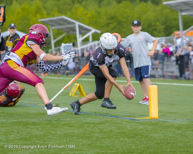 June 23rd, 2019 Ladysmith, BC (ISN) - Raider's talent Malik Gagne-Smith dives for the end zone for his Gordon Head's first TD - Erich Eichhorn image (www.allsportmedia.ca )
