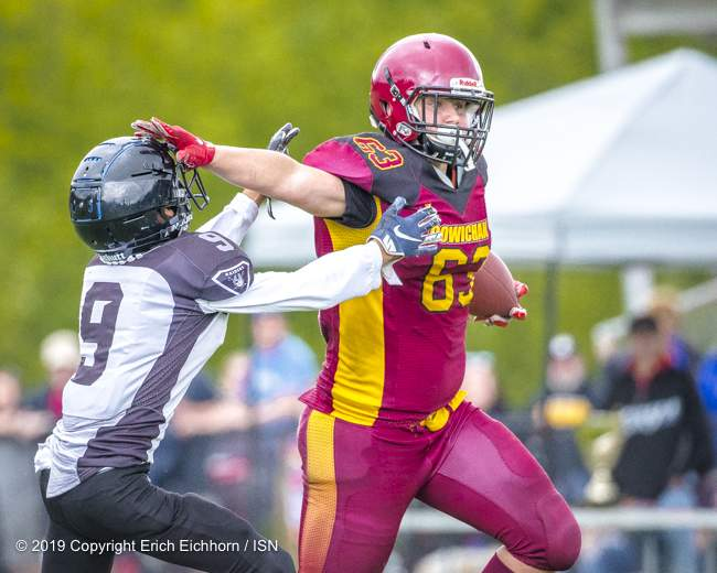 June 23rd, 2019 Ladysmith, BC (ISN) - Bulldog's Dillon Wilson holds off Jacob Greenway as he runs in for the TD on a pass for Niko Harris - Erich Eichhorn image (www.allsportmedia.ca )
