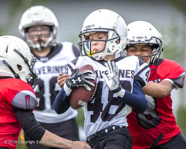 June 23rd, 2019 Ladysmith, BC (ISN) - Wolverines Jayshun Biegun carries the rock for yards - Erich Eichhorn image (www.allsportmedia.ca )