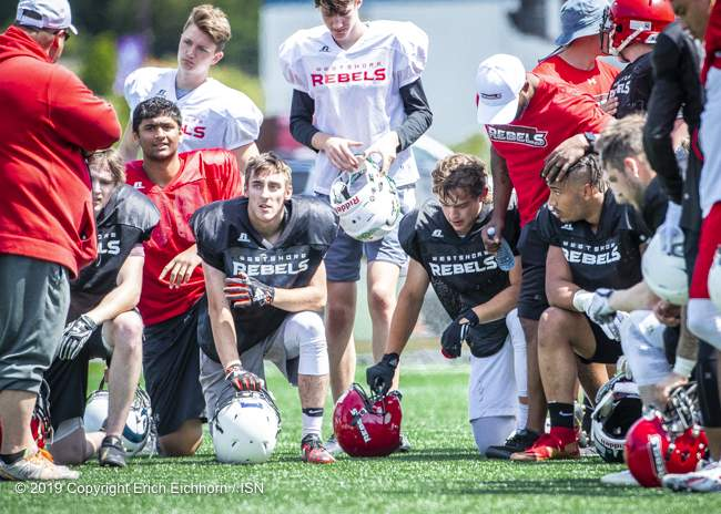June 1, 2019 Langford, BC (ISN) - Players take a knee as Rebels Head Coach Shane Beatty addresses them - Erich Eichhorn image (www.allsportmedia.ca)