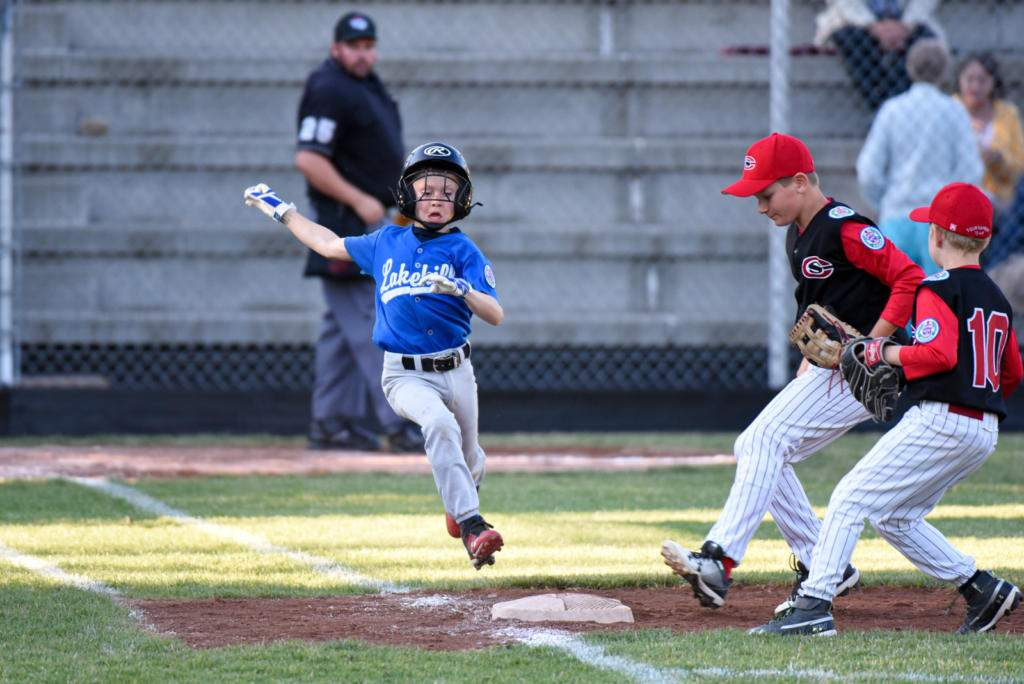 Lakehill's Blake Cameron is out at first. Lakehill taking on Central Saanich at the District 7 Little League Championship. Photo by Gord Rufh ISN Sports