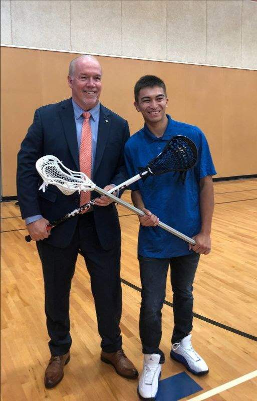 Premier John Horgan with Team BC lacrosse bronze medalist Mike Maresca
