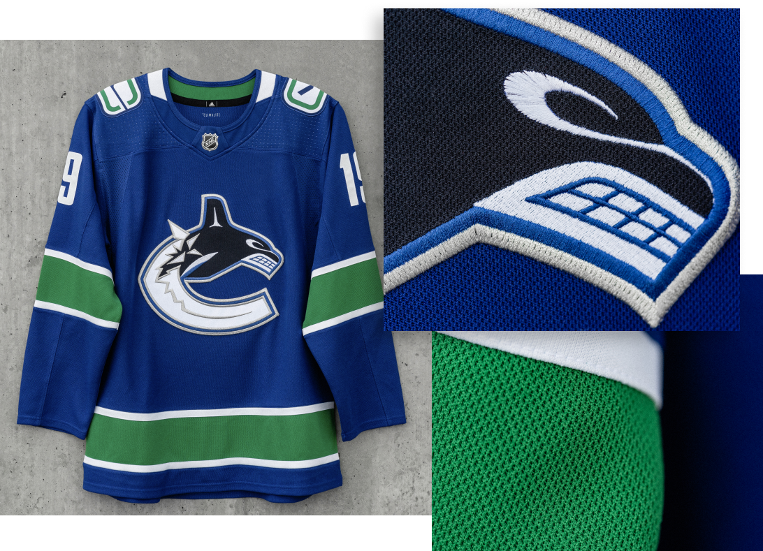 HOME JERSEY   With a clean, bold aesthetic the Orca is now positioned at the centre of both Home and Away Primary jerseys, absent the Vancouver wordmark. The change is also a reflection of a passionate Canucks fan base that extends throughout British Columbia. The Home jersey now also features a refreshed shoulder patch – the Stick and Rink mark that is featured on our Heritage jersey.