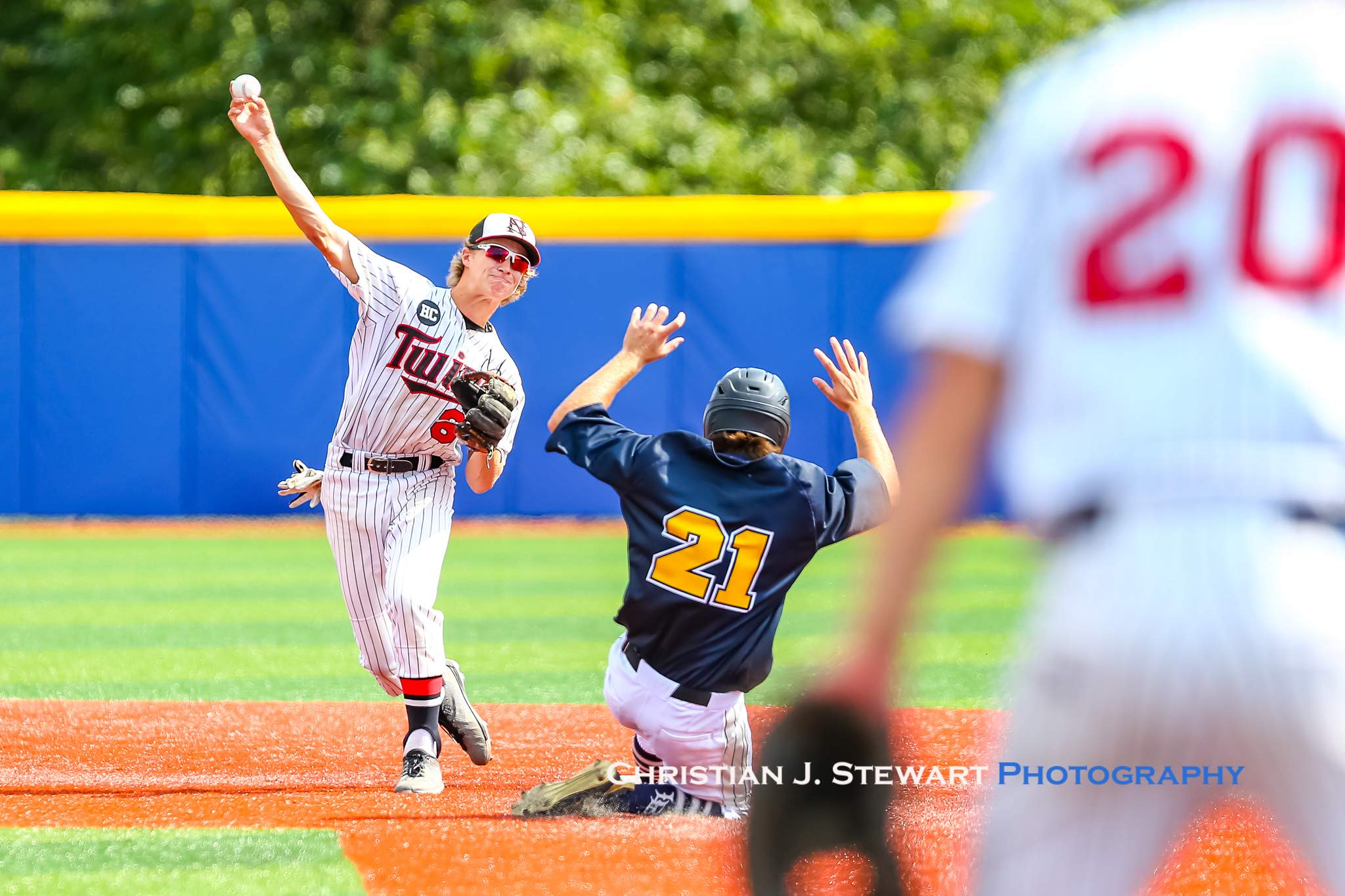 North Shore second baseman Griffin Palfrey turns the double play against the Blaze (Photo: Christian J. Stewart)