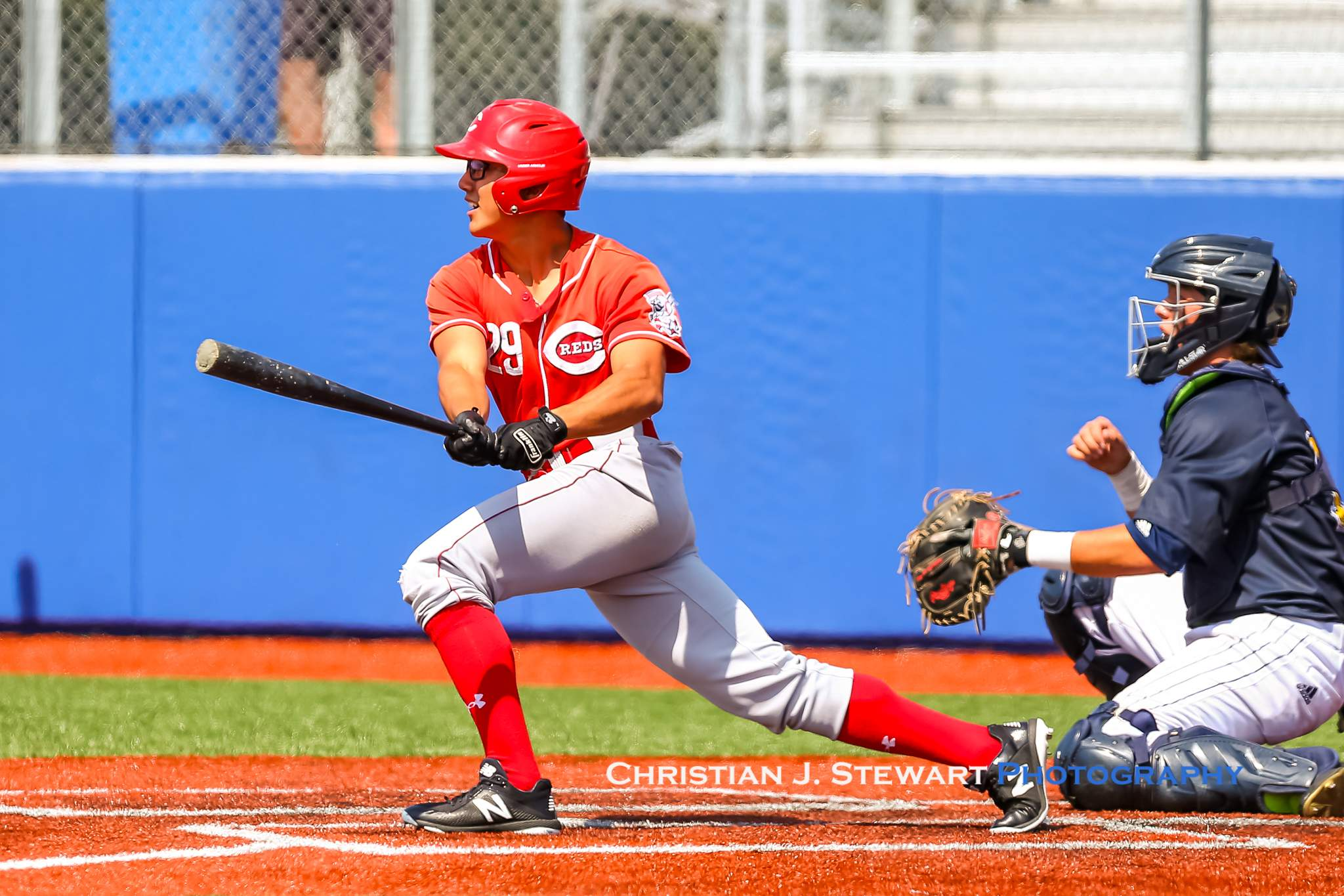 The Red's Williams Camacho Soto strokes one of his three hits against Langley Saturday (Photo: Christian J. Stewart)