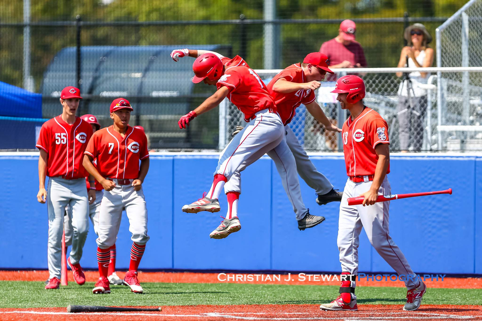 The Coquitlam Reds celebrate their go-ahead runs in the top of the sixth inning Saturday (Photo: Christian J. Stewart)