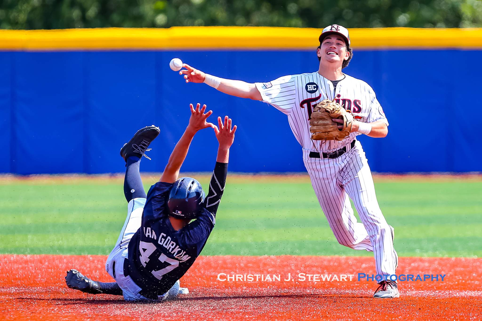 UBC's Luka Van Gorkum does his best to disrupt this double play turned by the Twin's Sam Van Snellenberg (Photo: Christian J. Stewart)