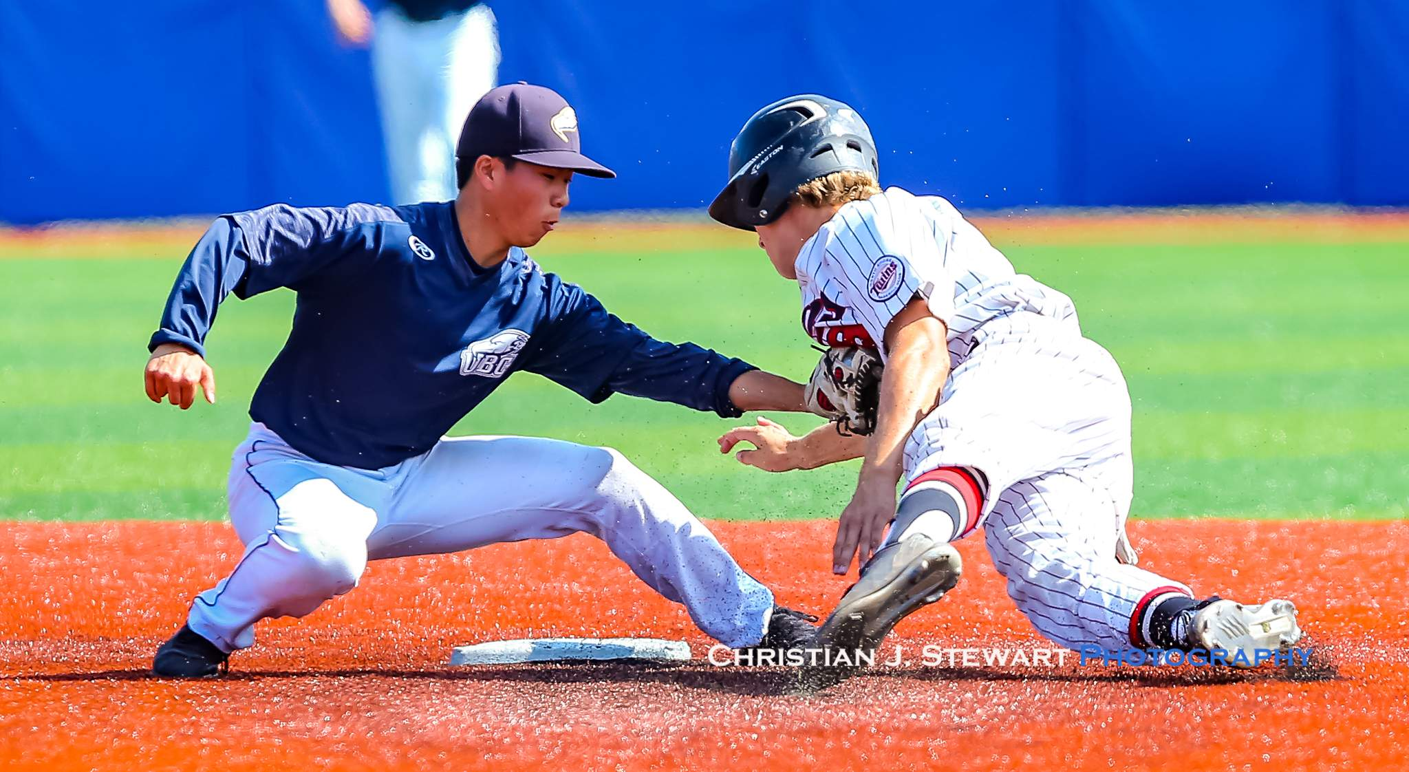 UBC second baseman Kai Koyama-Wong puts the tag on the Twin's Griffin Palfrey on this play in Sunday's game (Photo: Christian J. Stewart)