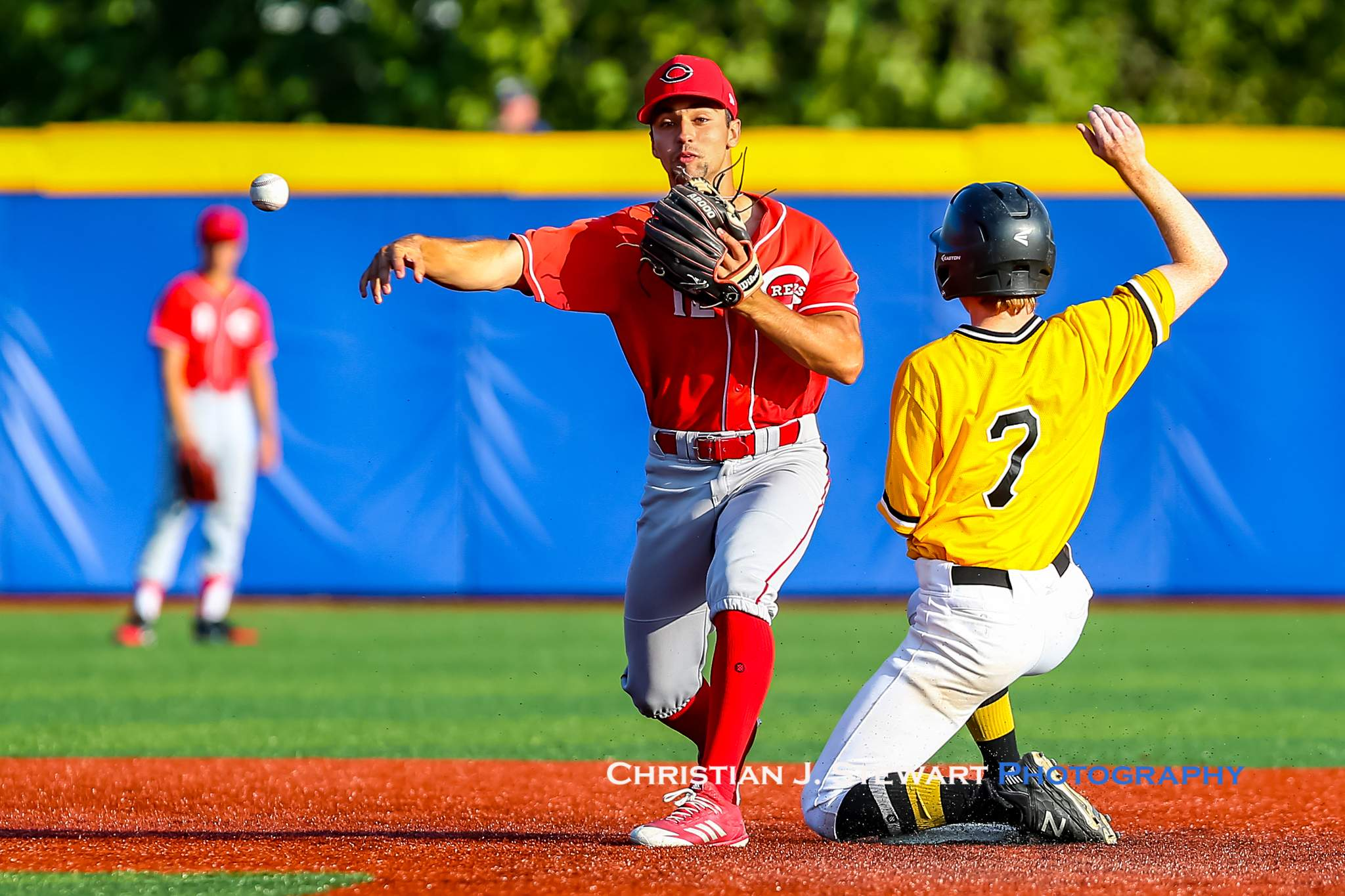 Reds second baseman Luciano Letteri turns the double play on the Pirates Jackson Stephen during the game Saturday night (Photo: Christian J. Stewart)