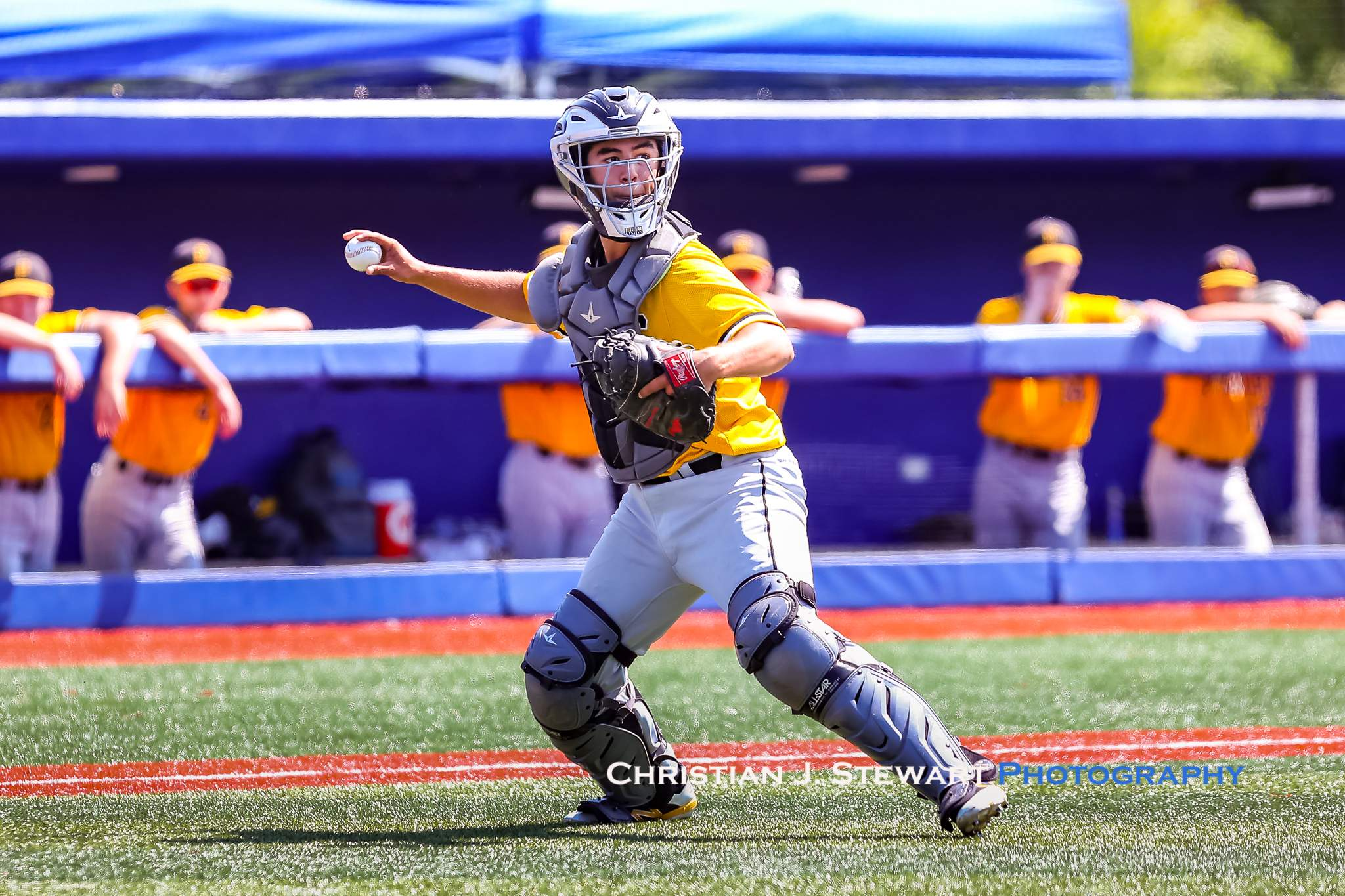 Mid-Island catcher Matthew Simpson gets set to throw to first in the semi-final Sunday (Photo: Christian J. Stewart)