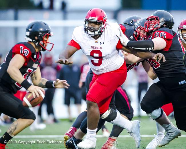 August 10, 2019 Victoria, BC (ISN) - Rebels' Leo Ingram is quickly being noticed for his explosive play of the defensive line as he beats his man on his way to the Raiders QB - Erich Eichhorn ( www.allsportmedia.ca)