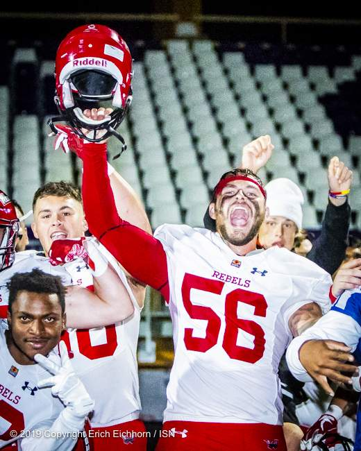 August 10, 2019 Victoria, BC (ISN) - A Rebel yell from Jesse Zarajos ( #56) and company post game. - Erich Eichhorn ( www.allsportmedia.ca)