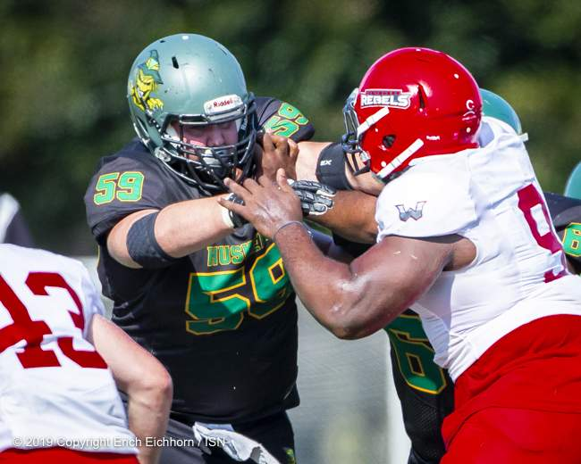 August 4th, 2019 Chilliwack, BC (ISN) - Rebels Leo Ingram, voted a one of the CJFL Top 50 players always playing physical - Erich Eichhorn image ( www.allsportmedia.ca )