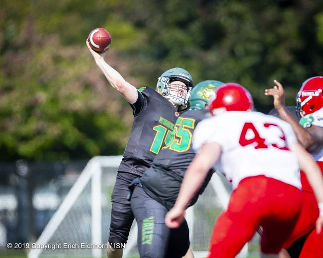 August 4th, 2019 Chilliwack, BC (ISN) - Starting Husker QB Reid Vankoughnett delivers the ball before the Rebel defence collapses around him - Erich Eichhorn image ( www.allsportmedia.ca )