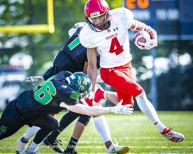August 4th, 2019 Chilliwack, BC (ISN) - Rebels Brycen Mayoh keeps Husker defender at arms length while gaining yards on the punt return - Erich Eichhorn image ( www.allsportmedia.ca )