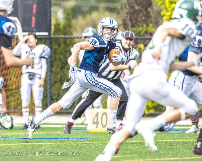 September 25, 2019.  Victoria, BC (ISN) - Belmont Beau Lewis-Nevramont takes the pick six to the house - Erich Eichhorn image (www.allsportmedia.ca)