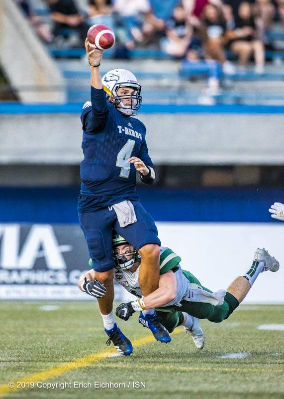 August 31, 2019. Vancouver, BC (ISN) -  Thunderbird's QB Yanchuk under pressure much of the game would be sacked five times in the match  - Erich Eichhorn image (www.allsportmedia.ca)