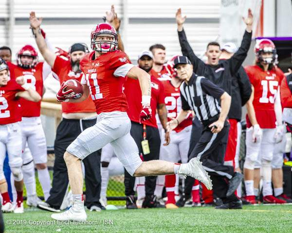 Septmber 16, 2019. Victoria, BC (ISN) - The Rebel sideline celebrates as Hayden Crothers sprints to the end zone after receiving a Lal pass. - Erich Eichhorn (www.allsportmedia.ca)