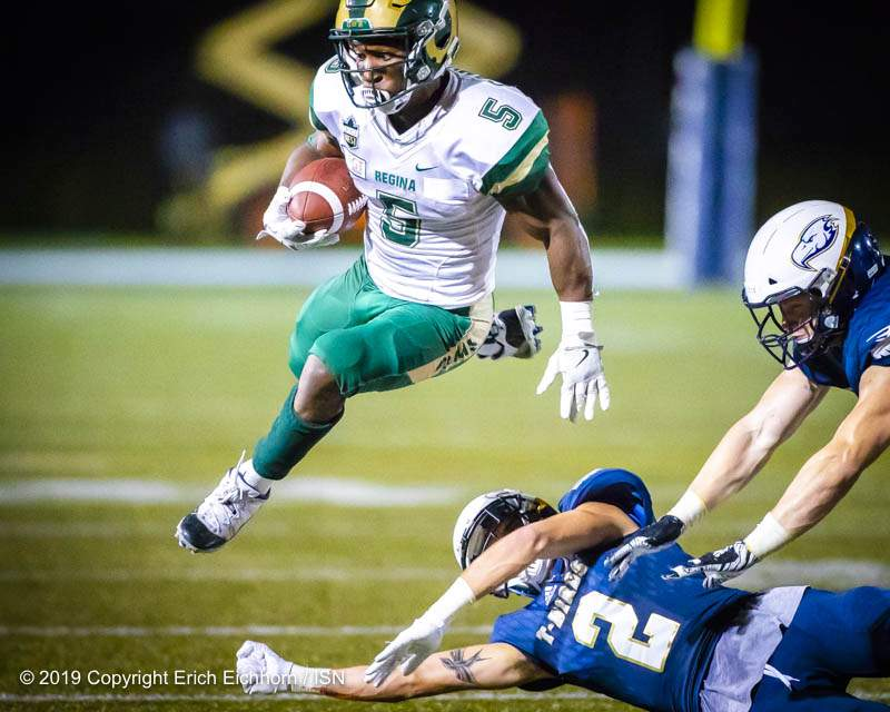 August 31, 2019. Vancouver, BC (ISN) -  Ram's RB Trey Campbell, after held in check much of the game, springs loose from the outstretched arms of the UBC tackler for the final TD of the game  - Erich Eichhorn image (www.allsportmedia.ca)