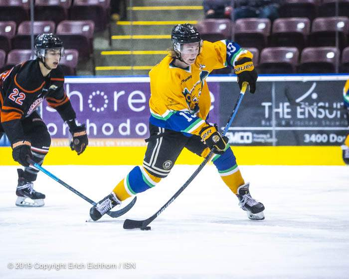 December 14, 2019. Victoria, BC (ISN) - Grizzlies' Cody Monds winds up for the shooting front of Nanaimo's Bennett. Monds would score two goals and a assist on the evening in a first star performance - Erich Eichhorn (www.allsportmedia.ca)