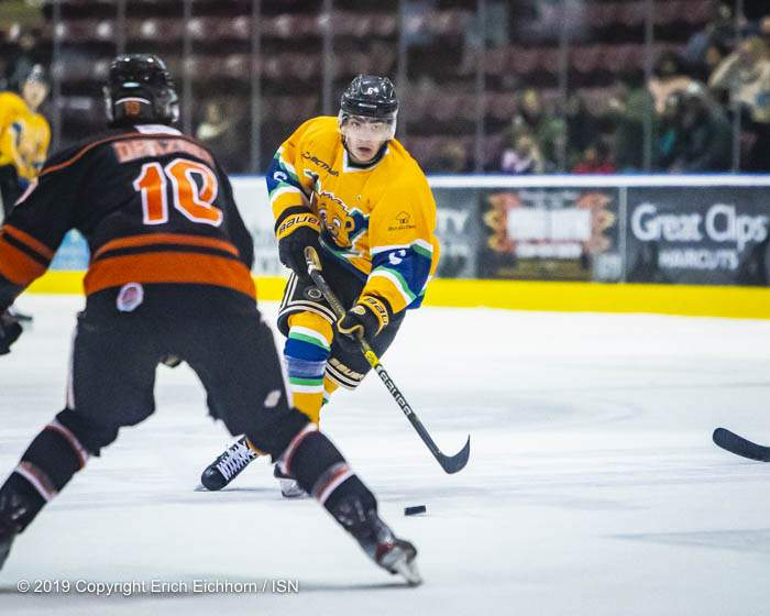 December 14, 2019. Victoria, BC (ISN) - The offensively-minded Kitchen skates in with the puck to back up Nanaimo's defence - Erich Eichhorn (www.allsportmedia.ca)