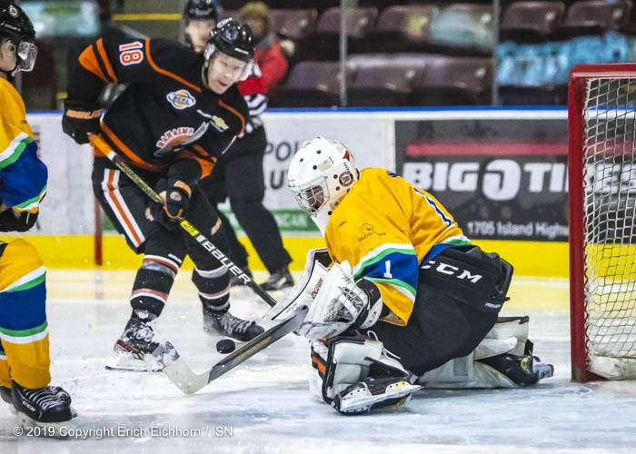 December 14, 2019. Victoria, BC (ISN) - Grizzlies' net minder Blake Wood would stop 44/46 shots on goal to backstop his eighth win of the season and secure the game's second star nod. with saves like this one stopping Clipper's Kyler Kovich. - Erich Eichhorn (www.allsportmedia.ca)
