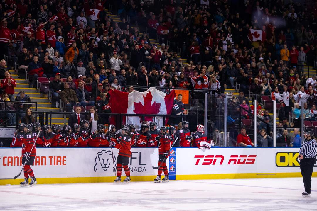 Team Canada celebrates after scoring the first goal of the game in front of  sea of red and white. Photo by Nathanael Laranjeiras
