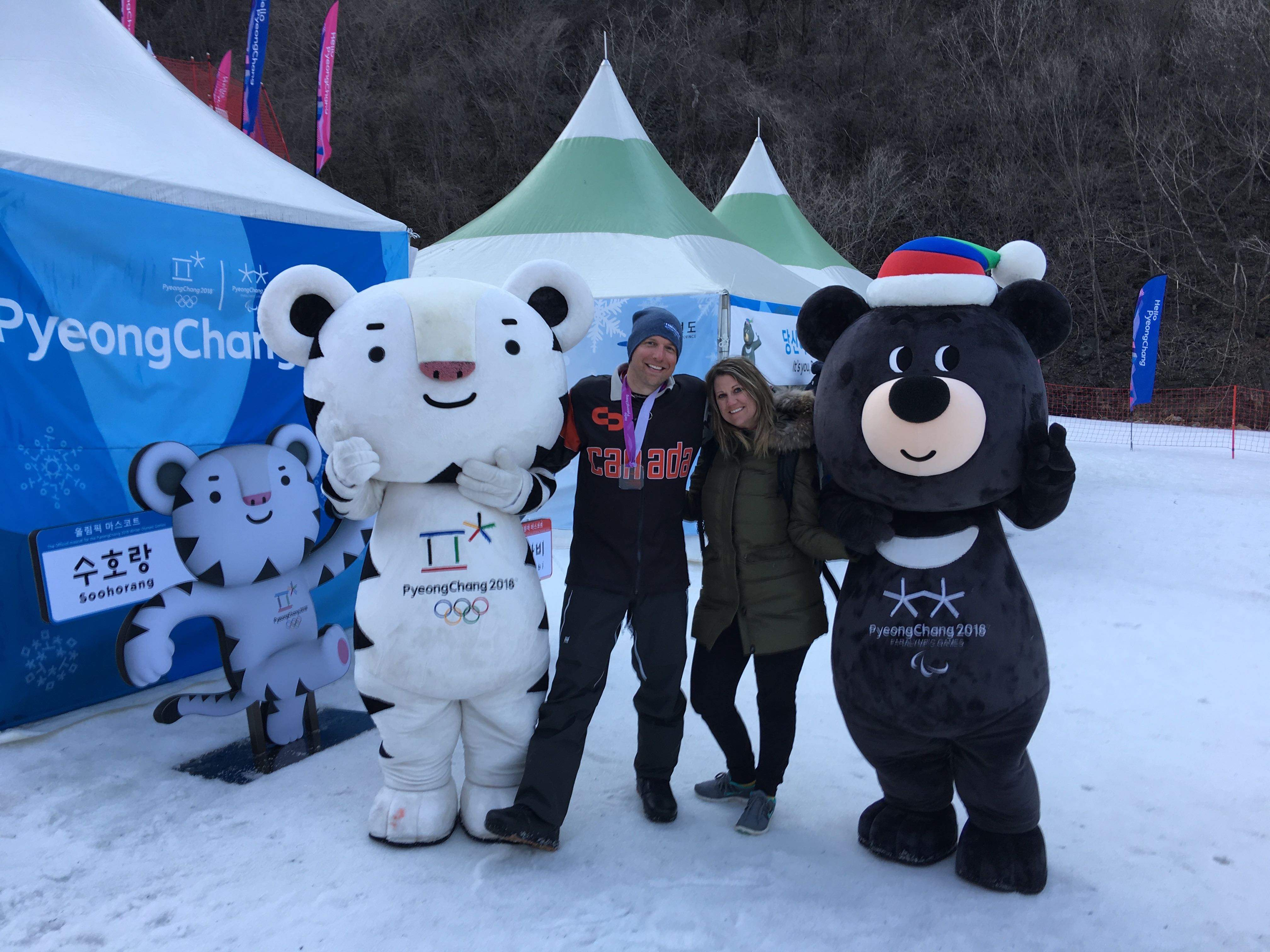 Celebrating his first World Cup medal, bronze, with his wife Heidi in Pyeongchang, 2017