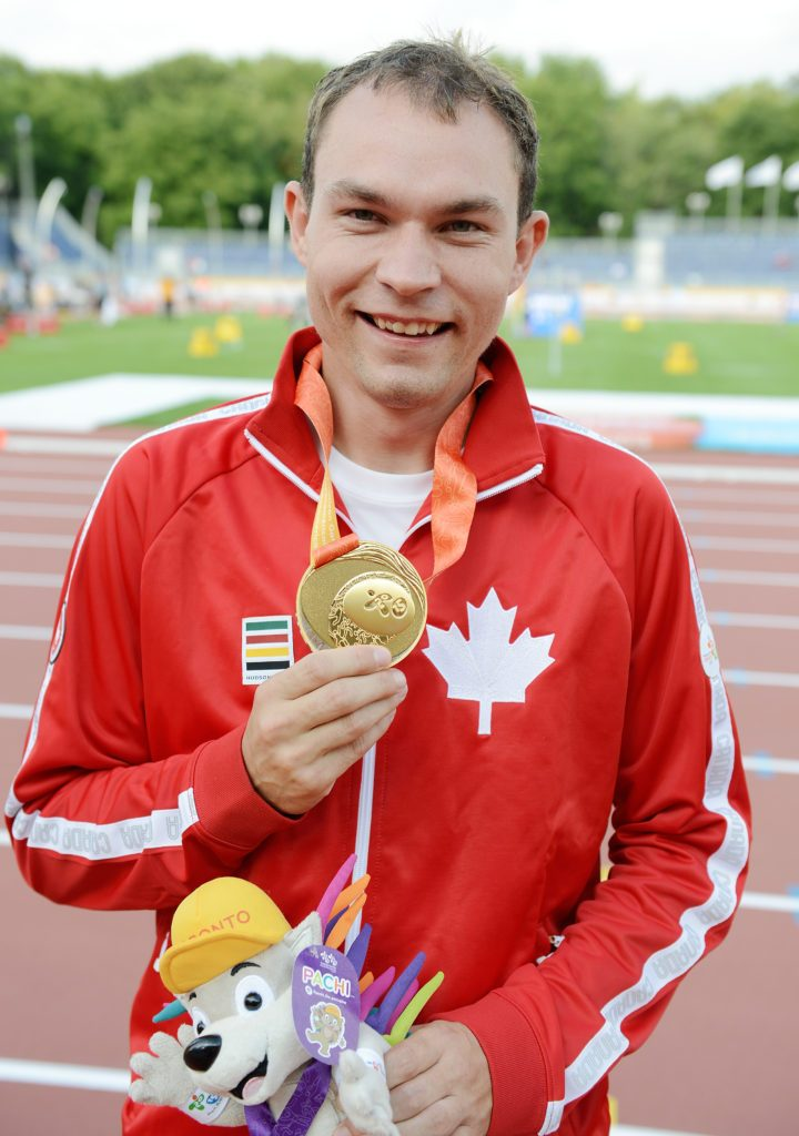 Toronto, ON - Aug 13 2015 - Kyle Whitehouse receives his Gold Medal for the Men's 200m T38 Final in the CIBC Athletics Stadium during the Toronto 2015 Parapan American Games  (Photo: Matthew Murnaghan/Canadian Paralympic Committee)