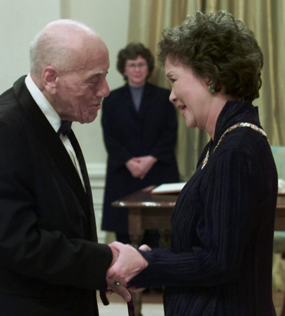 Governor General Adrienne Clarkson congratulates Raymond Lewis after investing him into the Order of Canada at a ceremony in Ottawa Wednesday Feb 28, 2001.(CP PHOTO/Tom Hanson)
